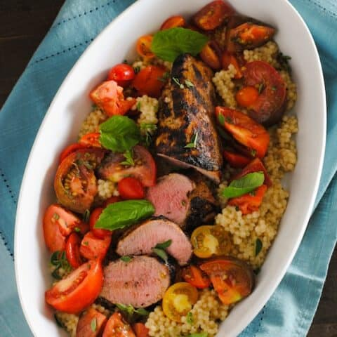 Grilled Pork Tenderloin with Couscous & Heirloom Tomato Salad - A summer meal that's as delicious as it is beautiful.   foxeslovelemons.com