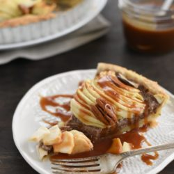 Apple & Pecan Tart with Bourbon Caramel Sauce - A flaky tart crust layered with homemade maple-pecan butter and apples, then drizzled with decadent bourbon caramel sauce! | foxeslovelemons.con