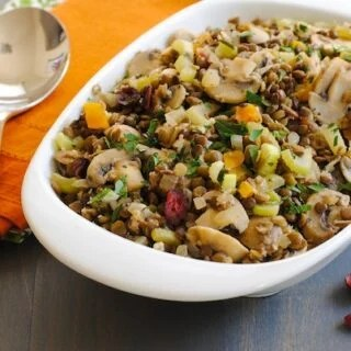 Lentil & Mushroom Dressing - A gluten-free stuffing/dressing that all your guests will enjoy! Includes two types of lentils, dried fruit and herbs.   foxeslovelemons.com