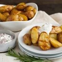 Super Crispy Roasted Potatoes with Shallot-Rosemary Yogurt - A simple technique for roasting potatoes that makes them SUPER crispy and delicious. Plus, a savory dipping sauce! | foxeslovelemons.com