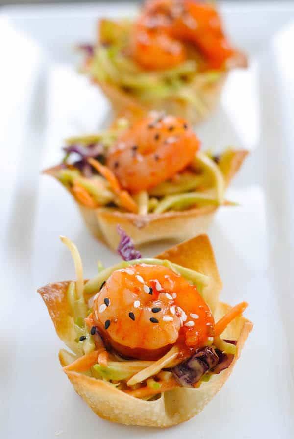 Asian Shrimp Wonton Cups - Crunchy wonton cups filled with broccoli slaw and topped with sweet chili glazed shrimp. Special yet incredibly simple!   foxeslovelemons.com