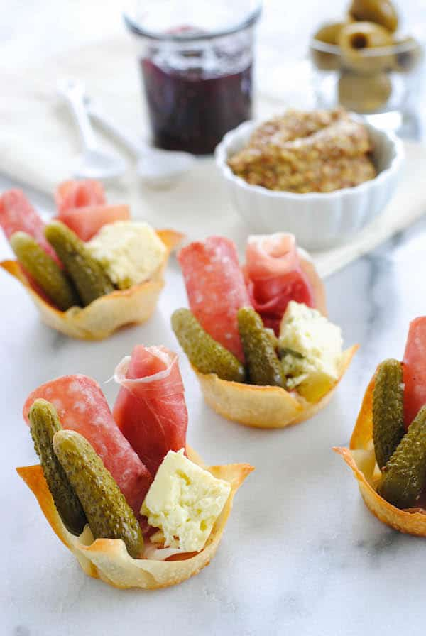 Charcuterie Party Cups - A charcuterie board in a personal-sized wonton cup appetizer!   foxeslovelemons.com