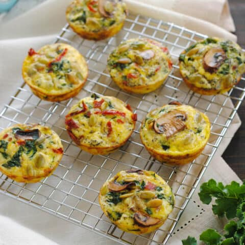 Make-Ahead Breakfast Muffins - Make these bacon, mushroom, kale and sundried tomato filled egg muffins in advance, then freeze them. In just a minute in the microwave, you'll have a healthy and tasty hot breakfast! Perfect for hosting house guests, parties and busy weekday mornings.   foxeslovelemons.com