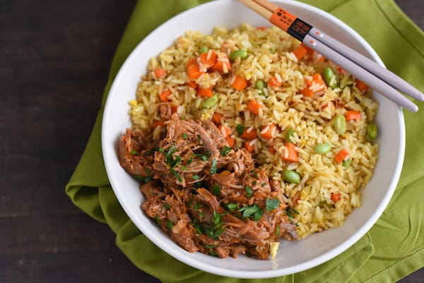 Slow Cooker Asian-Style Pulled Pork - A flavorful pulled pork that can be served in sandwiches, or with a side of rice! | foxeslovelemons.com