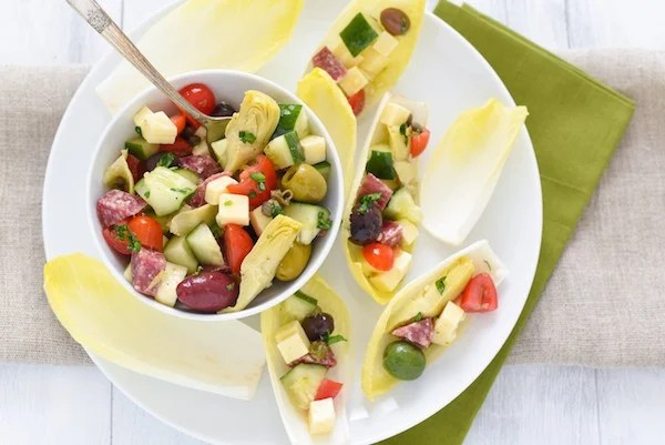 Antipasto Salad Endive Boats - Ditch the old-school relish tray and serve these no-fuss endive boats filled with your favorite meats, cheeses, olives and veggies! | foxeslovelemons.com