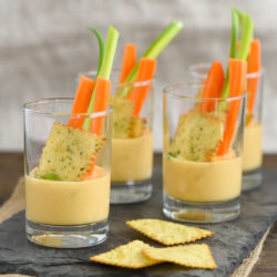 Beer Queso Dip Shooters - Silky smooth queso dip that STAYS silky smooth as it cools! | foxeslovelemons.com