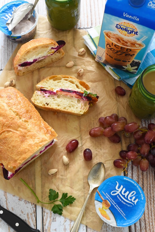 Beet, Blue Cheese & Pistachio Picnic Sandwich - Roasted beets, homemade blue cheese spread, pistachios and parsley on a big loaf of ciabatta bread. Slice and serve at a picnic or party, or eat for lunches throughout the week! | foxeslovelemons.com