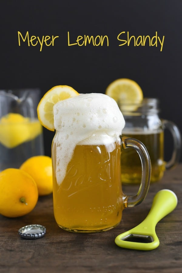 Homemade lemon shandy overflowing mason jar mug.