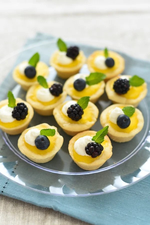 Mini Meyer Lemon Tarts with Ginger Cookie Crust - An adorable mini dessert perfect for baby and bridal showers, Easter, Mother's Day, or any Spring party! | foxeslovelemons.com