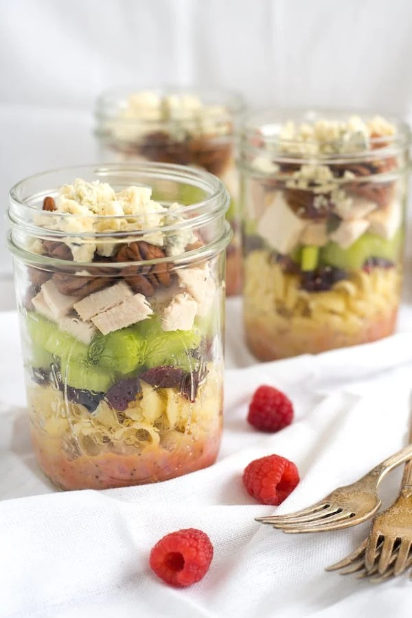 Sonoma Chicken Pasta Salad Jars - Portable and delicious lunches packed with pasta, dried cranberries, celery, chicken, pecans, blue cheese and homemade raspberry vinaigrette!   foxeslovelemons.com
