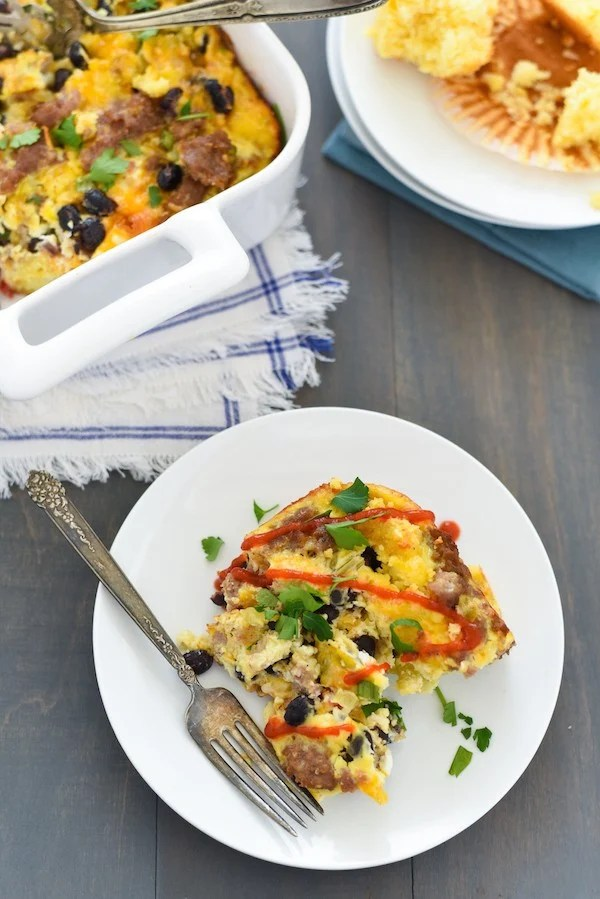 Southwestern Sausage & Cornbread Breakfast Casserole - A hearty but healthy egg casserole packed with turkey sausage, crumbled cornbread, black beans, green chiles and cheese. | foxeslovelemons.com