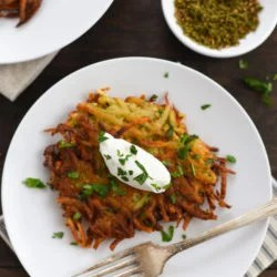 Spiced Potato & Carrot Latkes - Crispy and crunchy on the outside and light and fluffy on the inside, with tons of flavor in each bite. | foxeslovelemons.com