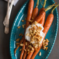 Roasted Glazed Carrots with Greek Yogurt & Buttered Pine Nuts - Carrots don't have to be a lowly side dish. These will be the highlight of your dinner plate, guaranteed!   foxeslovelemons.com