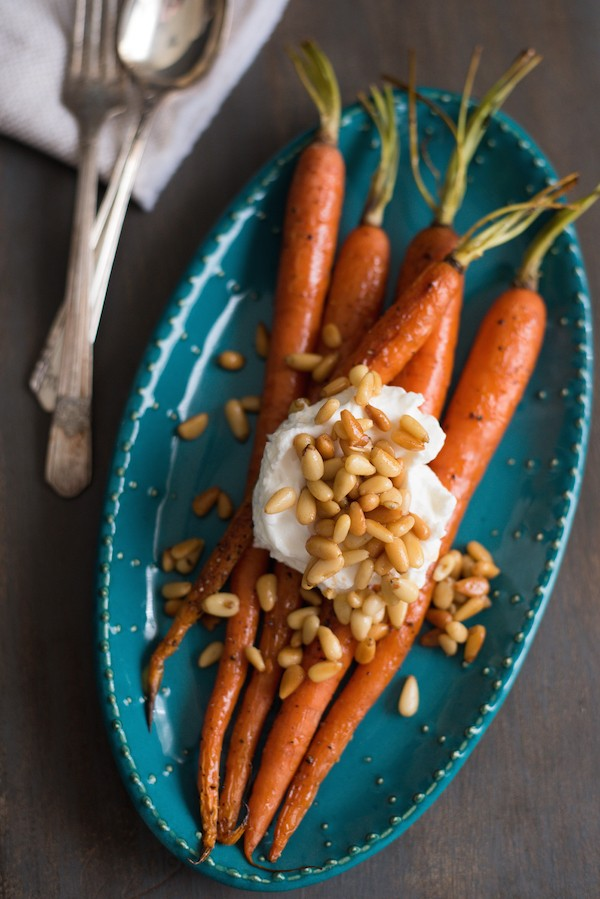 Roasted Glazed Carrots with Greek Yogurt & Buttered Pine Nuts - Carrots don't have to be a lowly side dish. These will be the highlight of your dinner plate, guaranteed! | foxeslovelemons.com