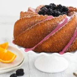 Orange Bundt Cake with Blackberry Icing - Rich vanilla cake flavored with orange zest, topped with a fresh blackberry icing. | foxeslovelemons.com