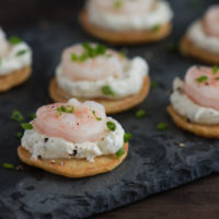 Cornmeal Pancake & Shrimp Appetizers - Elegant and delicious chilled appetizers, perfect for a special party! Mini cornmeal pancakes are topped with dill-horseradish cream and poached shrimp.   foxeslovelemons.com