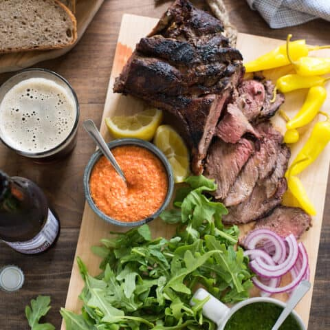 Grilled Lamb Sandwich Platter - Change up your grilling game with a boneless leg of lamb! It cooks in the same amount of time as a thick steak, and has a rich delicious flavor. Pile sandwich fixings, zesty feta spread, chimichurri and rye bread onto a big board, and dinner is served! | foxeslovelemons.com