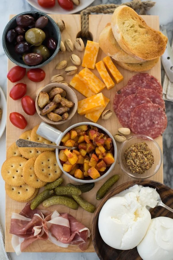"Summer Cheese & Charcuterie Board with Spicy Peach Chutney - Use a little help from your grocery store, pile everything onto a big cutting board and serve dinner ""platter"" style. Fresh summer peaches make a super-easy Spicy Peach Chutney. 