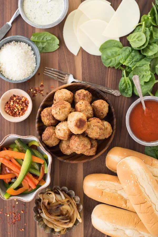 Build-Your-Own Meatball Sub Platter - Pile all the fixings for delicious meatball subs onto a big platter, and let everybody create their own meal! | foxeslovelemons.com