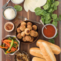 Build-Your-Own Meatball Sub Platter - Pile all the fixings for delicious meatball subs onto a big platter, and let everybody create their own meal!   foxeslovelemons.com