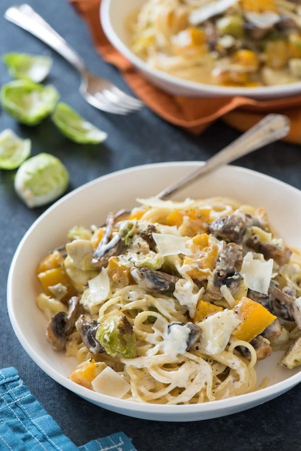 Creamy Roasted Autumn Vegetable Pasta - Celebrate fall's bounty with this creamy pasta tossed with roasted butternut squash, brussels sprouts and mushrooms.   foxeslovelemons.com