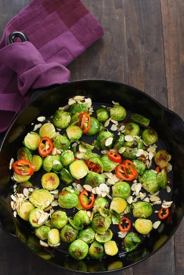 Lemon & Maple Glazed Roasted Brussels Sprouts - Roasted brussels sprouts with a tangy-sweet glaze, almonds and chile pepper. | foxeslovelemons.com