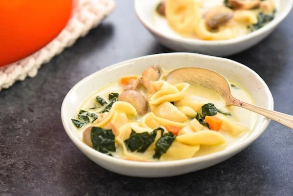 Creamy Chicken, Tortellini & Mushroom Soup - Serve up comfort the whole family will love with this easy one-pot meal. Bonus: lots of veggies!   foxeslovelemons.com