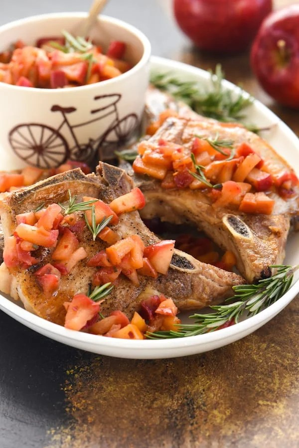 Pork Chops with Spicy Applesauce - An updated take on a classic favorite. Just a handful of ingredients come together to create this simple and healthful meal!   foxeslovelemons.com