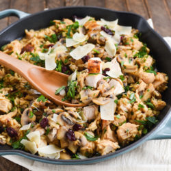 Turkey, Mushroom & Cranberry Risotto - Pure winter comfort food in a skillet. Arborio rice, sautéed mushrooms, turkey breast, dried cranberries and Parmesan cheese come together in this creamy, dreamy rice dish.   foxeslovelemons.com