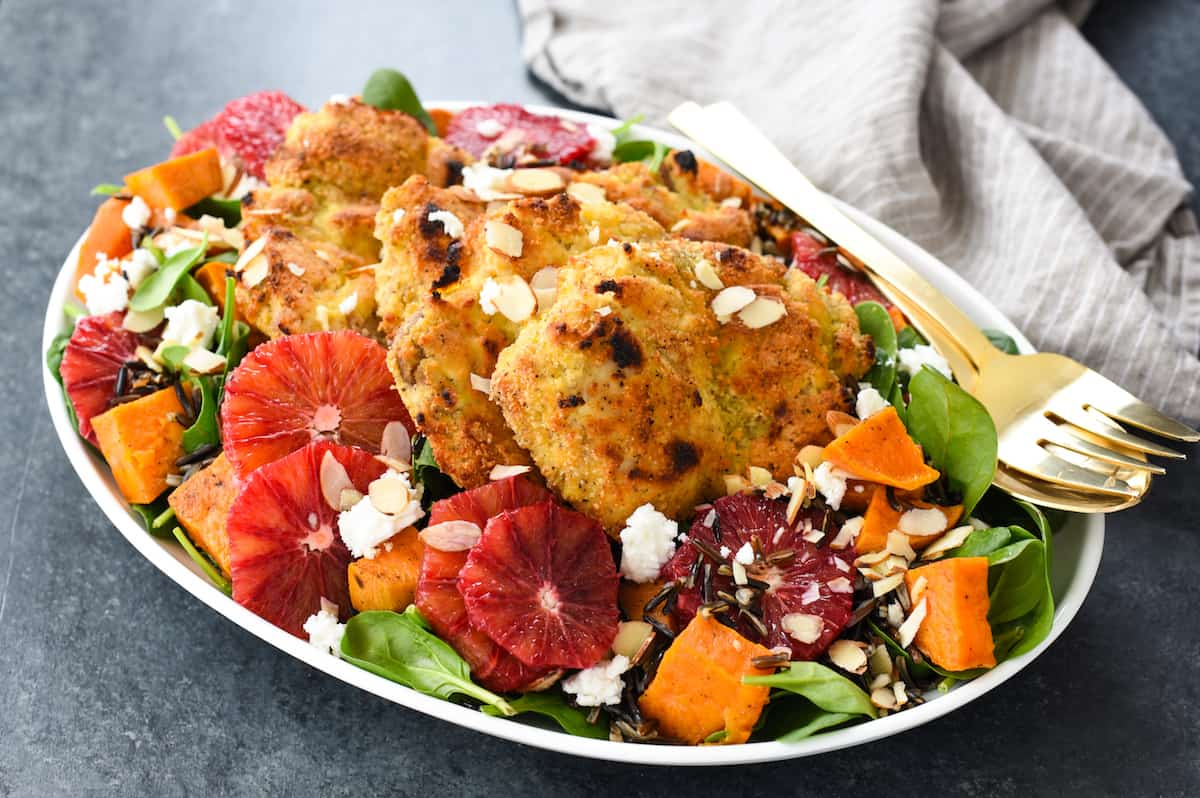 Almond-Crusted Chicken Thighs with Winter Wild Rice Salad - A big platter of winter comfort food masquerading as a salad. Feast your eyes, and your tastebuds, on this healthful, beautiful meal.   foxeslovelemons.com