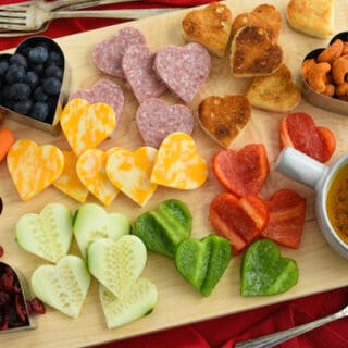 Grab a heart-shaped cookie cutter and put together these easy and fun Valentine's Day Snacks for your kids, friends, or sweetheart.   foxeslovelemons.com