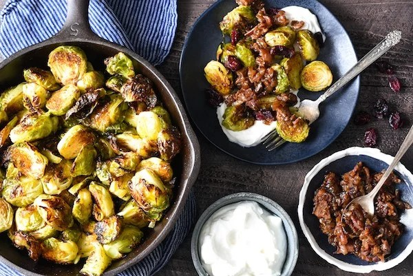 Roasted Brussels Sprouts with Greek Yogurt & Bacon Jam - A restaurant-quality side dish that you can easily serve at home. The whole family will eat their vegetables with this one! | foxeslovelemons.com