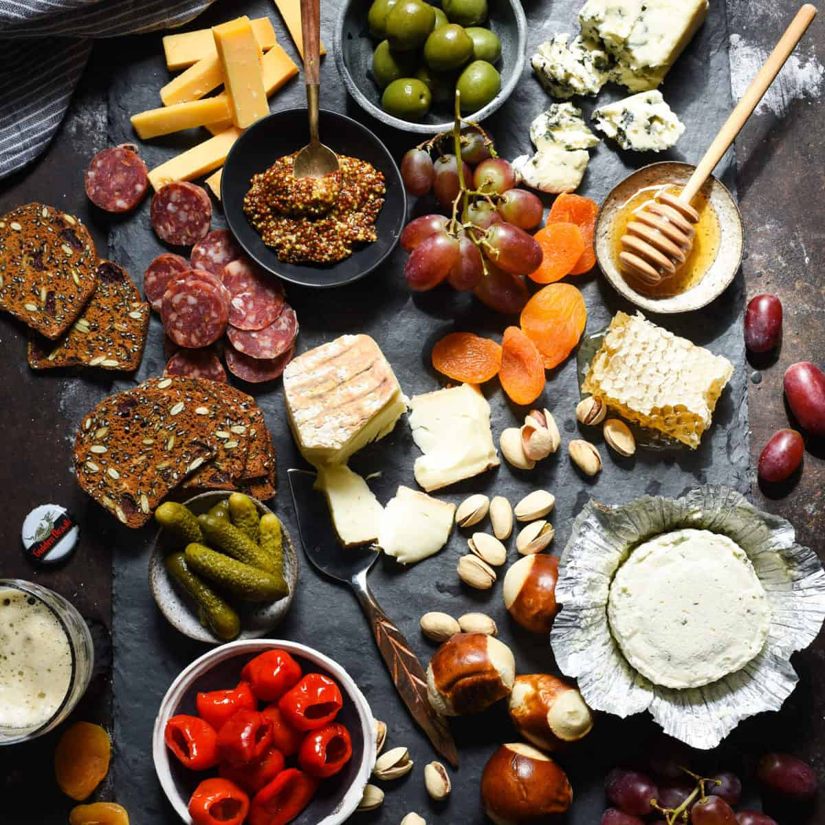 Cheese Board for Beer - All of the salty, spicy, creamy, nutty and pickled items you need to assemble an appetizer spread perfect for a beer-tasting party.   foxeslovelemons.com