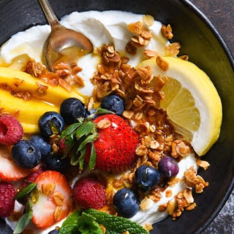 Lemon Cardamom Coconut Granola - Spice up your yogurt and granola routine with this exotic cardamom- and lemon-infused granola.   foxeslovelemons.com