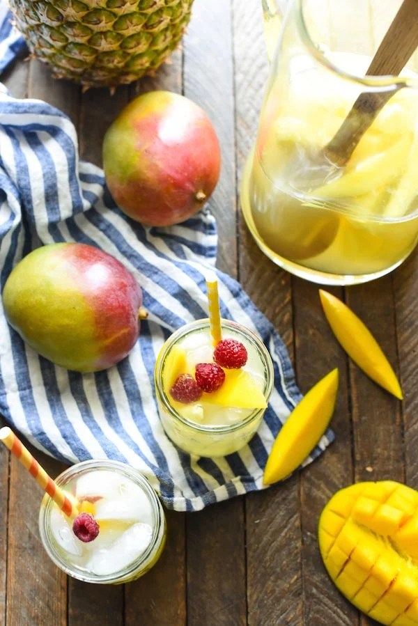 Mango-Pineapple Sangria - This fruit summer drink is a breeze to stir together, can be made in advance, and serves a crowd! | foxeslovelemons.com