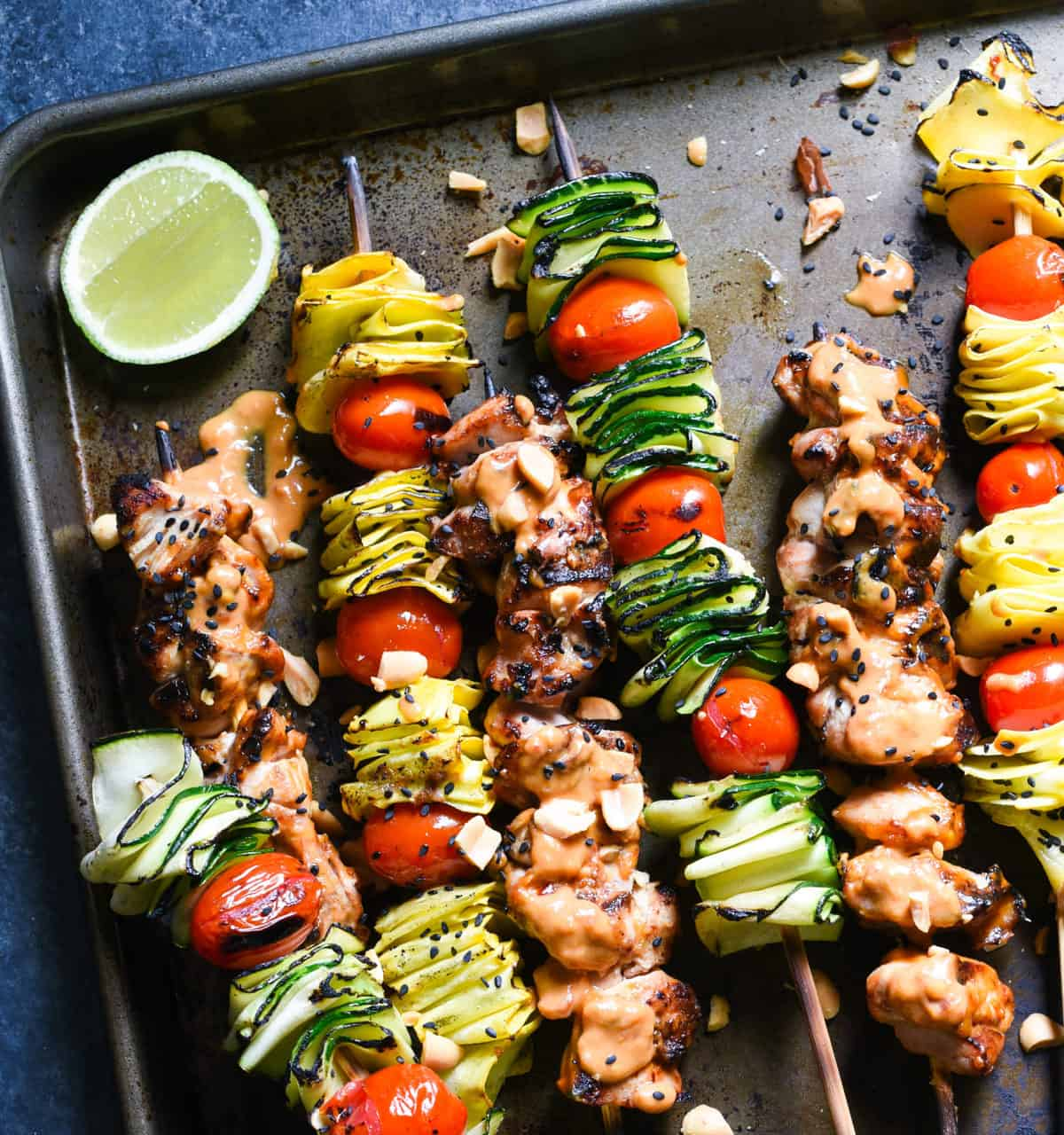 Spicy Peanut Chicken Skewers - The whole family will love this easy grilled take on peanut chicken satay. Serve with veggie skewers for a complete meal!   foxeslovelemons.com