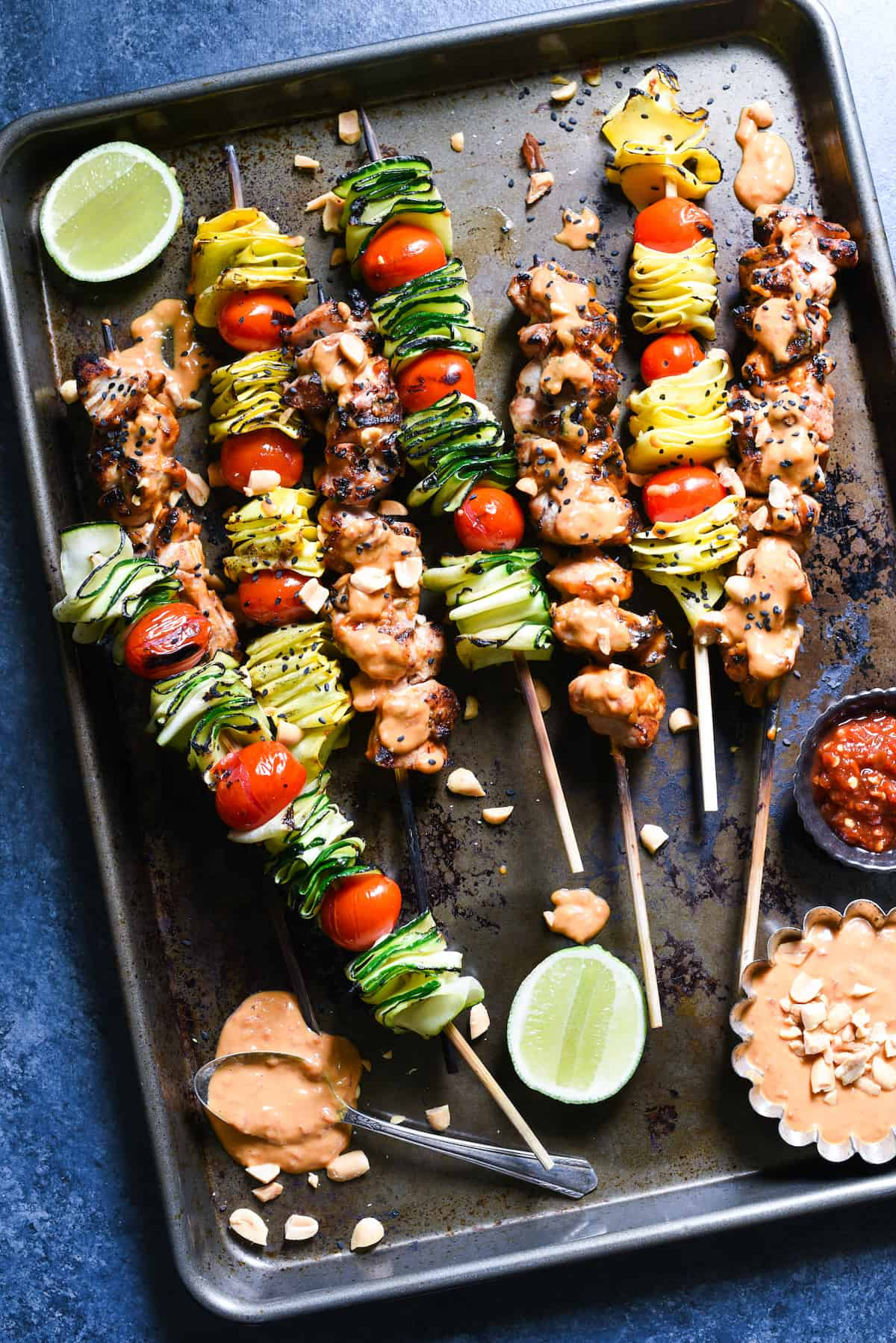 Spicy Peanut Chicken Skewers - The whole family will love this easy grilled take on peanut chicken satay. Serve with veggie skewers for a complete meal! | foxeslovelemons.com