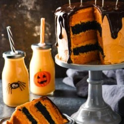 Orange Cream Cake with Chocolate Ganache - Spook your family and friends with this decadent five-layer drip cake. | foxeslovelemons.com