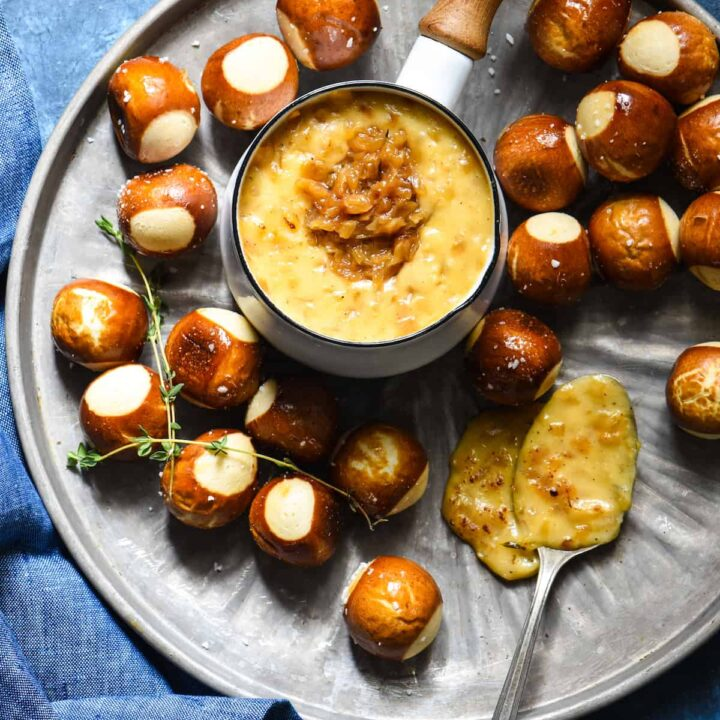 French Onion Cheese Fondue - An ooey gooey three-cheese fondue studded with deeply caramelized onions. | foxeslovelemons.com