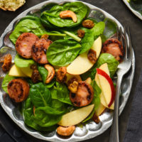 Apple Sausage Salad with Curry Yogurt Dressing - Chances are, you probably have most of the ingredients for this fresh and healthy meal in your kitchen right now. Spinach, sausage, apples, raisins and spiced cashews are served with an easy curry yogurt dressing. | foxeslovelemons.com
