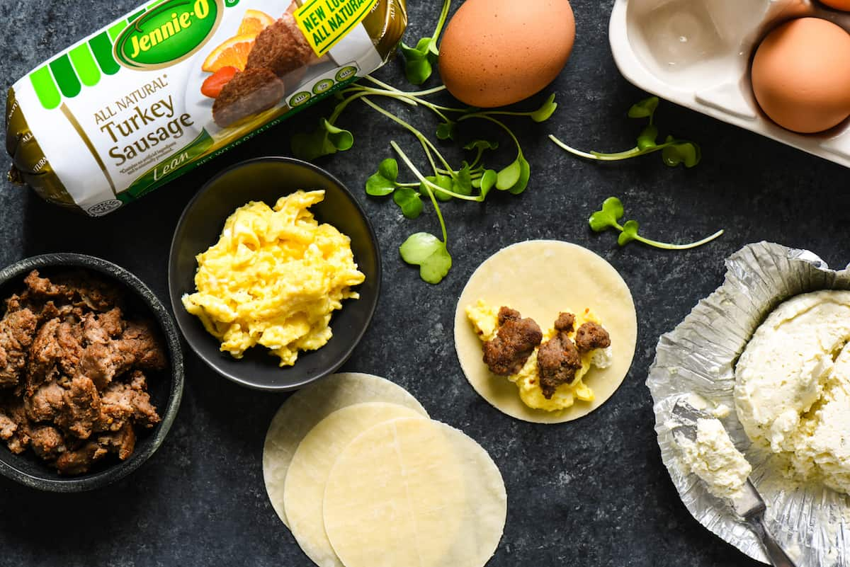 Lazy Sunday Breakfast Dumplings - Make brunch fun again with these sausage, egg and cheese wontons served with two easy dipping sauces. | foxeslovelemons.com