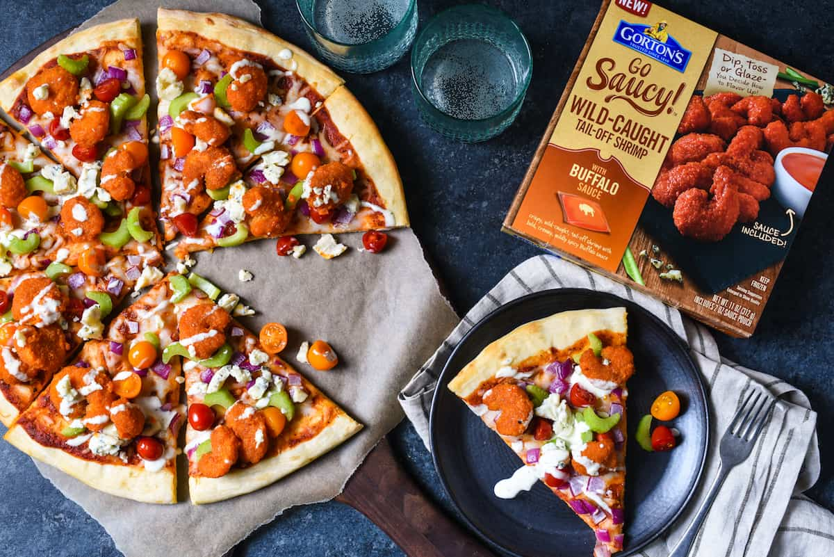 Buffalo Shrimp Pizza - Shake up pizza night with this weeknight-easy recipe! Buffalo shrimp, celery, two kinds of cheese and ranch dressing = flavors the whole family will love. | foxeslovelemons.com