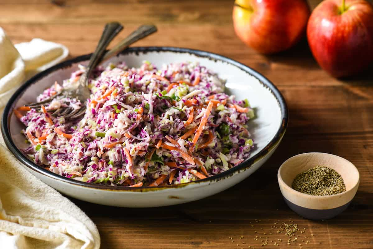 Sweet Celery Seed Apple Slaw - This apple slaw is unique twist on classic coleslaw with a touch of sweetness. The perfect side dish to just about any summer entrée! | foxeslovelemons.com