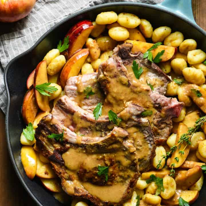Bring dinner to the table in a single pan with this Skillet Pork Chops with Apple Gnocchi Sauté recipe. Glaze everything with a hard cider sauce (or sub traditional apple cider) for a restaurant-quality meal that YOU can make at home on a weeknight. | foxeslovelemons.com
