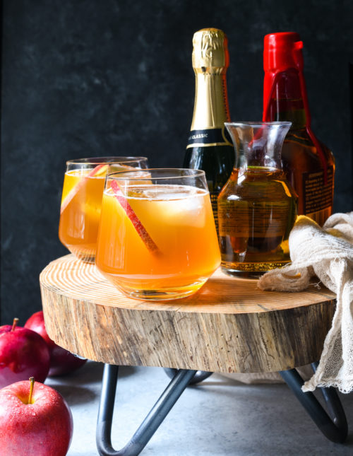 Serve a crowd with this Bourbon Apple Cider Punch! Don't be stuck in the kitchen making a craft cocktail for each party guest. With just 4 simple ingredients, this spiked punch can be stirred together in just a minute. Use bourbon, rum, or any other spirit you like.  | foxeslovelemons.com