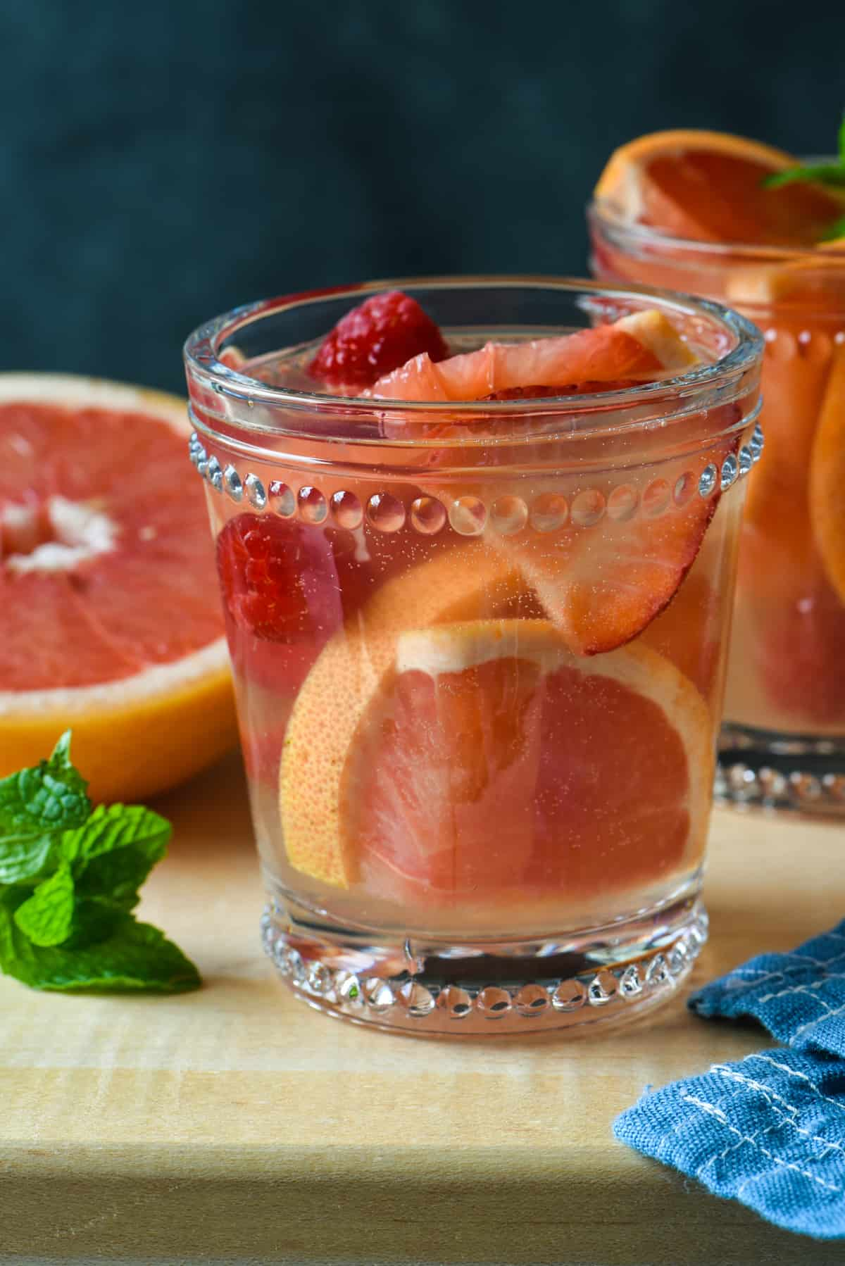 Grapefruit Sangria + 11 Grapefruit Recipes to Brighten Your Winter - Bring some happy flavor to a cold day with an appetizer, cocktail, breakfast, salad, lunch or dinner celebrating juicy, sweet grapefruit! | foxeslovelemons.com