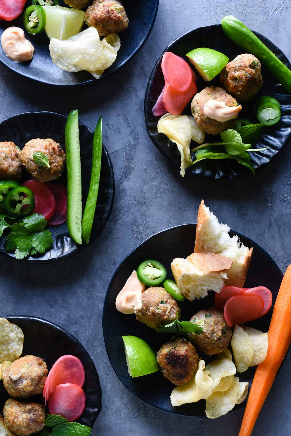 This Banh Mi Meatball Snack Dinner is a healthful platter of fresh ingredients that the whole family will love. Turkey meatballs, fresh and pickled veggies, bread, potato chips and dipping sauce - it's a fun meal that comes together easily. | foxeslovelemons.com
