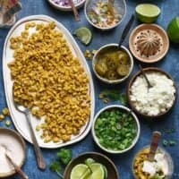 Having a fiesta? Please the whole crowd with thisMexican Street Corn Salad Bar. Gather all of the ingredients for classic Mexican street corn (elote), but let everybody assemble their own. Perfect for the spice lovers, the picky eaters, and the cilantro-adverse!   foxeslovelemons.com