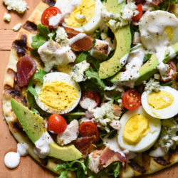 Do you love grilled pizzas but are a bit intimidated by making them? Take an easy shortcut with naan bread for these Grilled Cobb Flatbreads. Even a novice griller will have no problem whipping these up! | foxeslovelemons.com