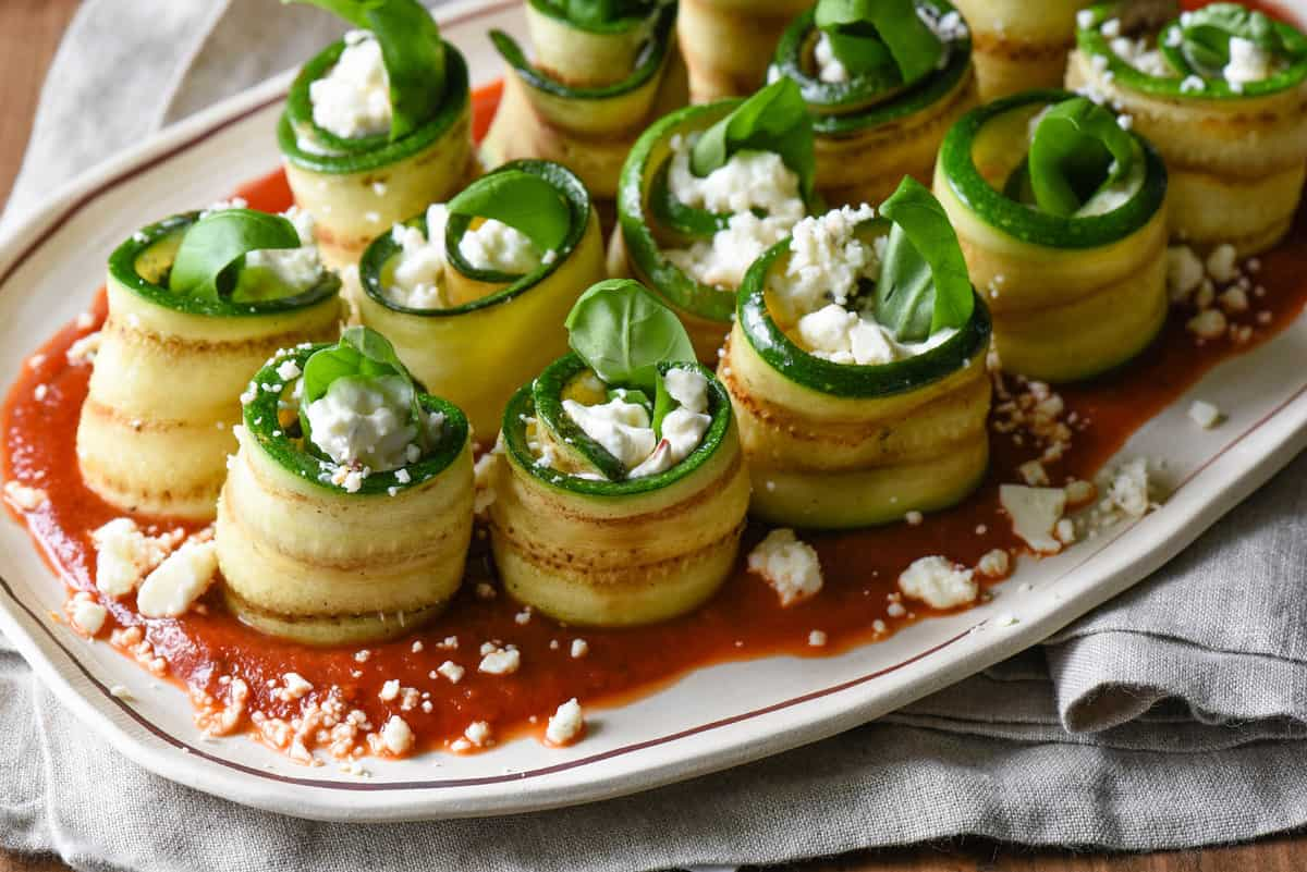Use your grill to prepare these easy but elegant Grilled Zucchini Roll Ups with Feta. Serve as a party appetizer, a vegetable side dish, or even a light summer meal. | foxeslovelemons.com